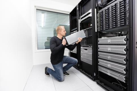 IT guy building server rack